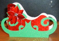 sleigh box and poinsettia decoration
