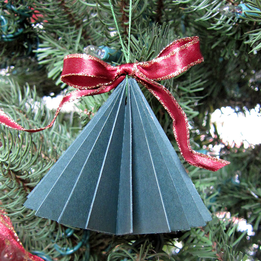 12 paper ornaments of christmas pine tree folded