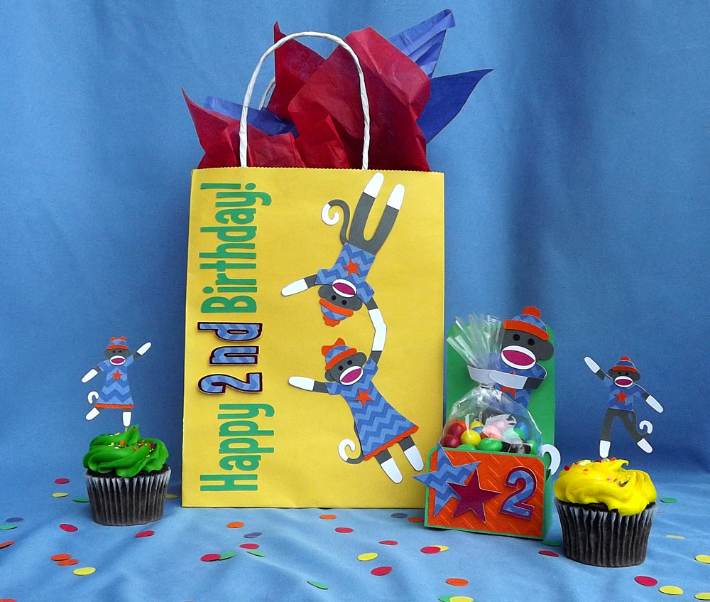 Monkey themed birthday party set with toy monkey cutting files.