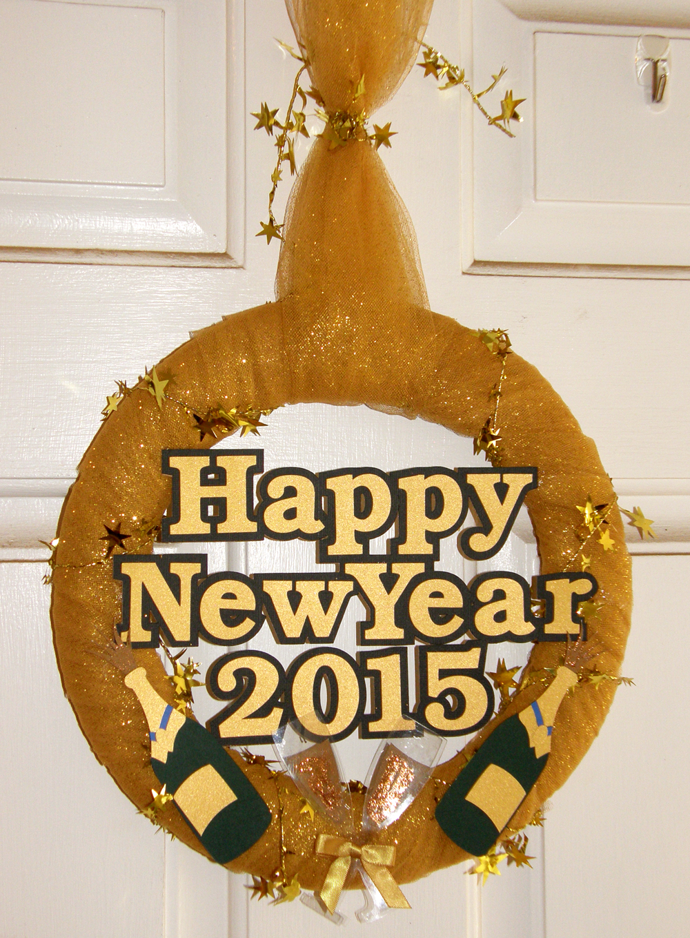 Happy New Year Wreath Decoration. Make your own wreath form from cereal boxes and your electronic die cutter.