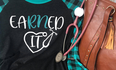 Pazzles EaRNed It DIY Nurse Shirt with instant SVG download. Compatible with all major electronic cutters including Pazzles Inspiration, Cricut, and Silhouette Cameo. Design by Leslie Hix.