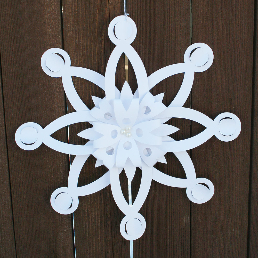 folded dimensional paper snowflakes
