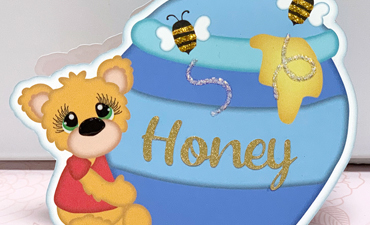 Pazzles DIY Honey Bear Card with instant SVG download. Compatible with all major electronic cutters including Pazzles Inspiration, Cricut, and Silhouette Cameo. Design by Lisa Reyna.